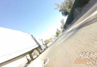 Везунчик года: мотоциклист упал и боком проехал под фурой (ВИДЕО)