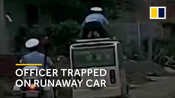 Фото №1 - Особенности китайской погони: хулиган 12 км катал полицейского на крыше (ВИДЕО)
