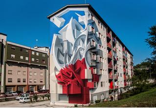 Художник расписывает дома трехмерными граффити