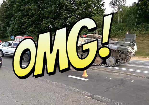 Фото №1 - Ух, ёлки! БМП наезжает на легковушку и подминает ее под себя! (ВИДЕО)