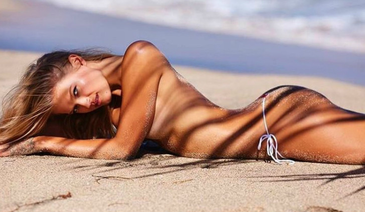Фото №1 - Русская модель снялась в знаменитом на весь мир пляжном приложении! Гордимся!