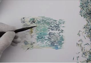 Посмотри видео и разинь рот: парень складывает купюру из миллиона частичек порезанных купюр!
