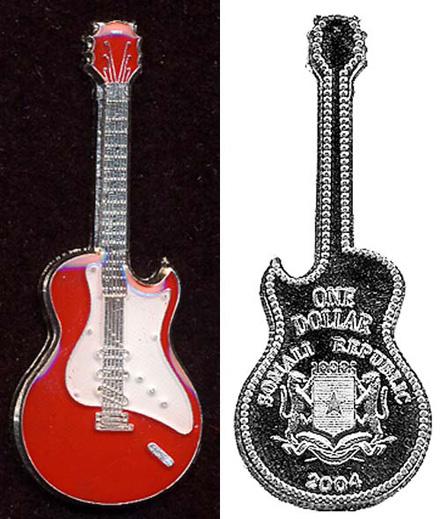 Монеты в форме гитар