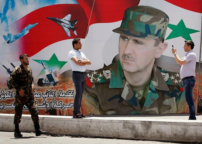 Портрет Башара Асада на плакате