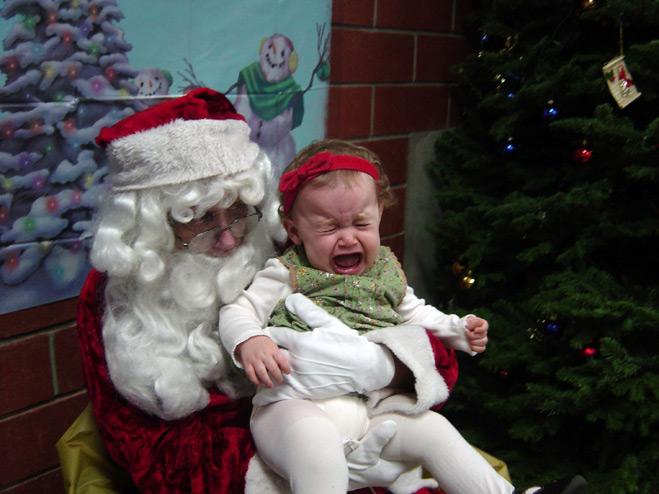 Фото девочки и Санта-Клауса