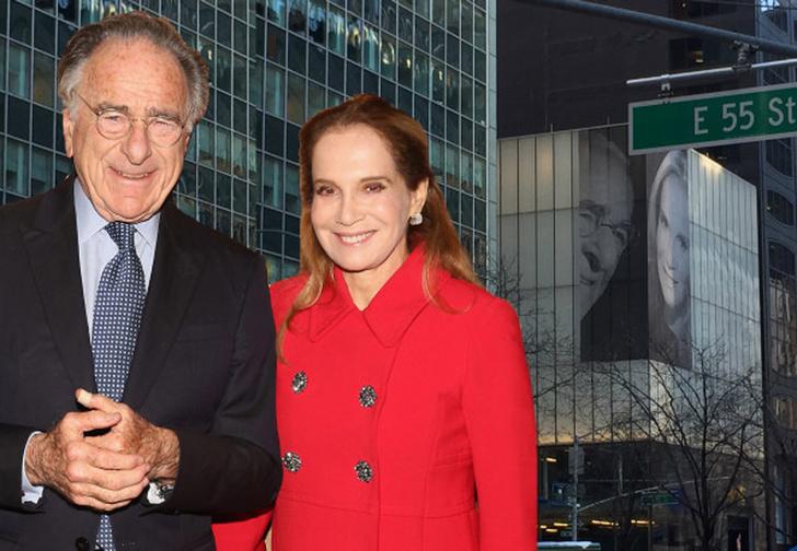 Фото №1 - Миллиардер повесил на фасад здания огромное фото с новой женой, чтобы позлить бывшую