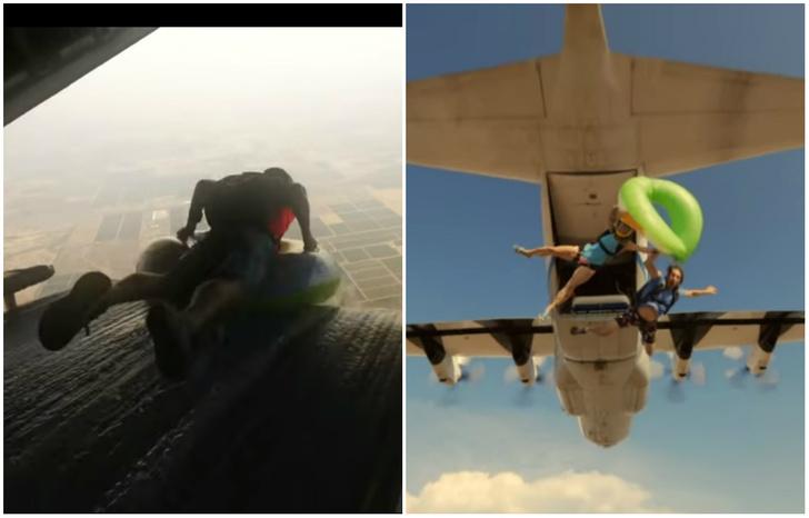 Фото №1 - Парашютисты на детских кругах скользят по водяной горке в самолете и выпадают из него (видео)