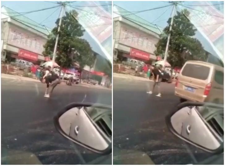 Фото №1 - Парень пытается перейти дорогу, но его шлепанцы прилипают к асфальту (героическое ВИДЕО)